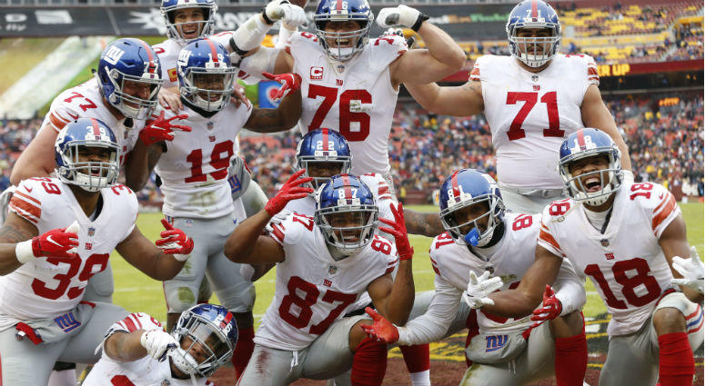 Sterling Shepard celebrates with teammates after catching a touchdown pass against the Washington Redskins in the second quarter at FedEx Field.