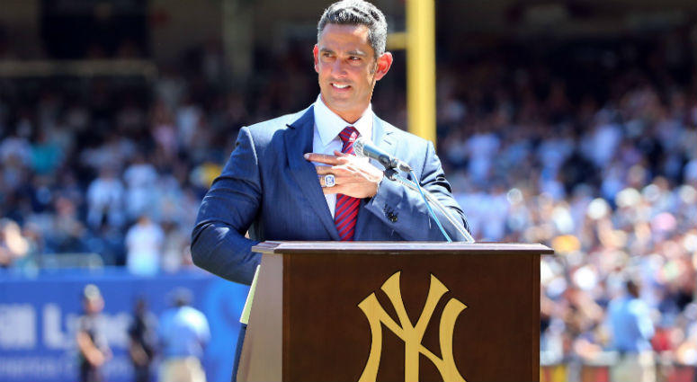 Jorge Posada address the crowd during a ceremony for the retirement of his number before the game against the Cleveland Indians at Yankee Stadium