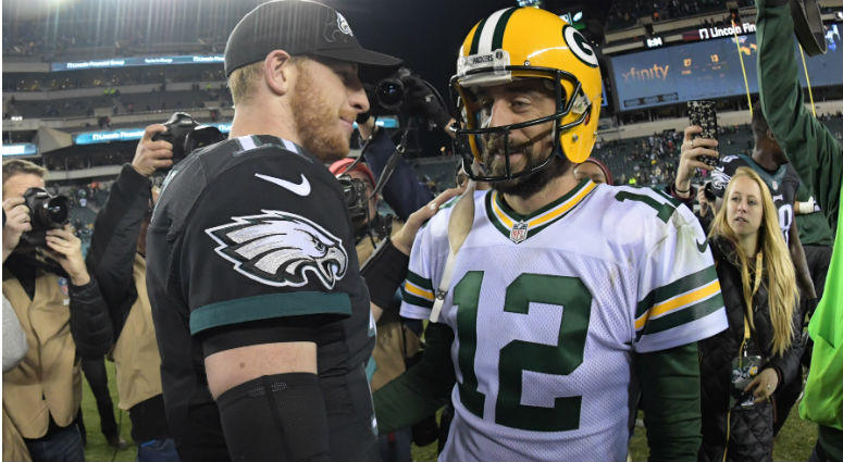 Carson Wentz and Aaron Rodgers shake hands after a NFL football game at Lincoln Financial Field in Philadelphia.