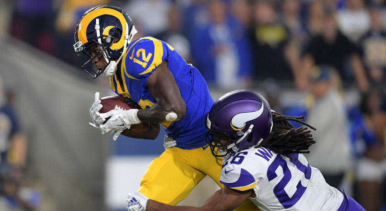Rams wide receiver Brandin Cooks (12) is defended by Minnesota Vikings cornerback Trae Waynes on a 47-yard touchdown reception on Sept. 27, 2018, at Los Angeles Memorial Coliseum.