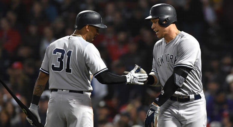 Yankees right fielder Aaron Judge (99) reacts with center fielder Aaron Hicks (31) after hitting a home run during the eighth inning against the Boston Red Sox at Fenway Park on Sept. 28, 2018..