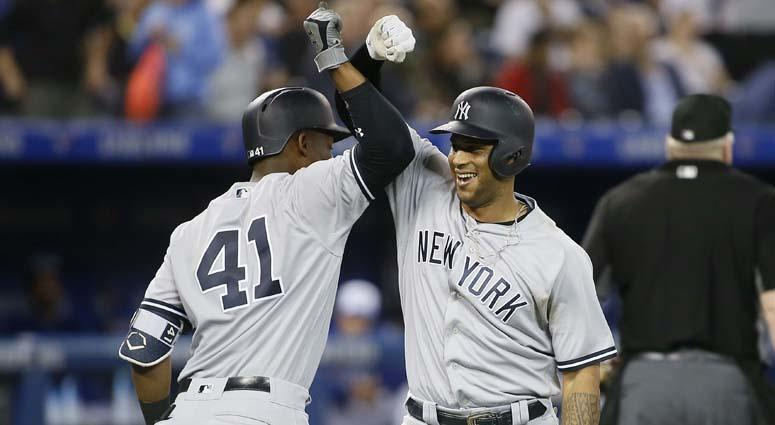 Yankees center fielder Aaron Hicks celebrates his three-run home run with third baseman Miguel Andujar (41) against the Blue Jays on June 5, 2018, at the Rogers Centre in Toronto.