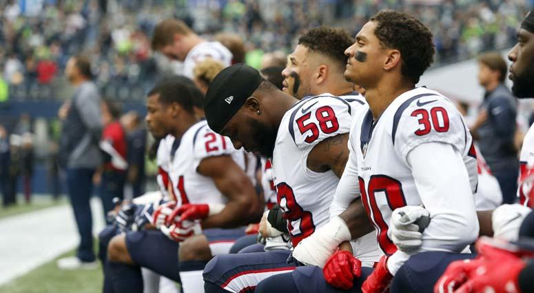 Some members of the Houston Texans kneel during the national anthem on Oct. 29, 2017.