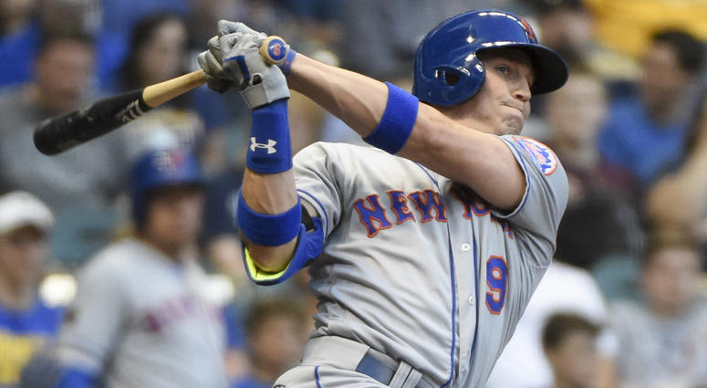 Brandon Nimmo of the Mets scores a triple against the Milwaukee Brewers on April 24, 2018 at Miller Park.
