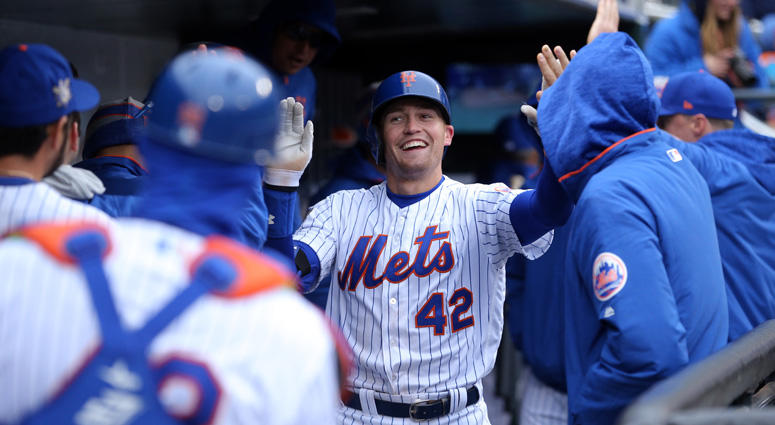The Mets Brandon Nimmo celebrates with teammates after hitting a solo home run against the Milwaukee Brewers during the sixth inning at Citi Field.