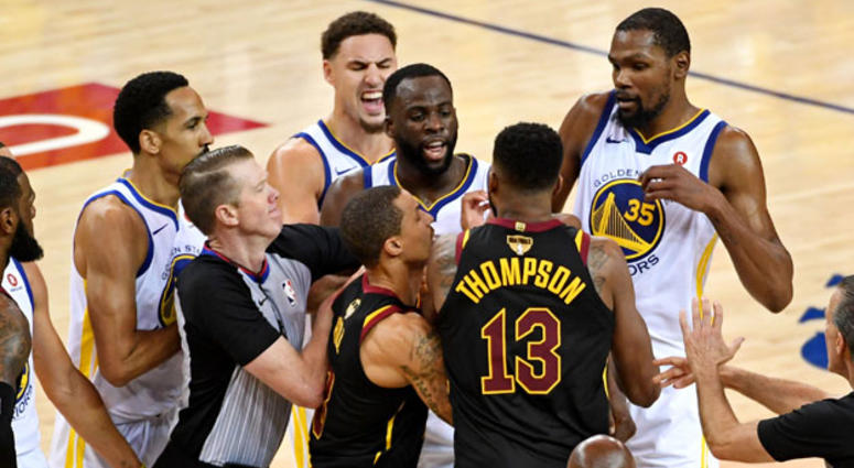 Cleveland Cavaliers center Tristan Thompson (13) and Golden State Warriors forward Draymond Green (23) argue during overtime in Game 1 of the NBA Finals on May 31, 2018, at Oracle Arena in Orlando, Florida.