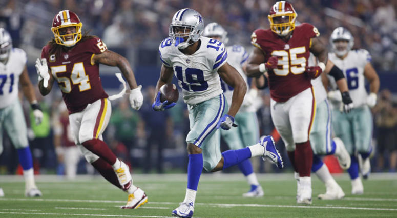 Cowboys wide receiver Amari Cooper (19) runs for a touchdown after catching a pass in the third quarter against the Washington Redskins at AT&T Stadium in Arlington, Texas.