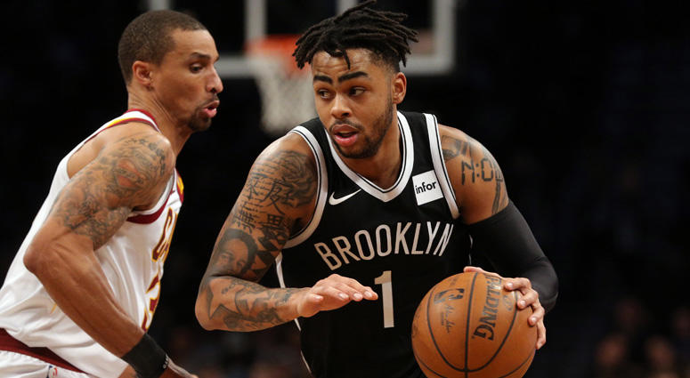 Nets point guard D'Angelo Russell drives around Cleveland Cavaliers point guard George Hill on March 25, 2018, at the Barclays Center.