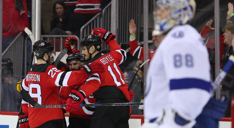 hall has goal 2 assists as devils rally past lightning in game 3 5