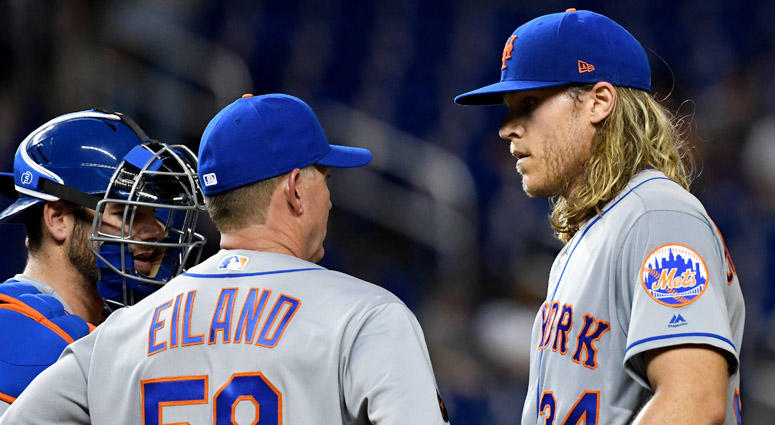 Mets pitching coach Dave Eiland talks to Noah Syndergaard on April 9, 2018, at Marlins Park in Miami.