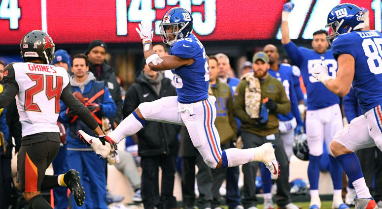 Giants running back Saquon Barkley leaps for a first down against the Tampa Bay Buccaneers on Nov. 18, 2018, at MetLife Stadium.
