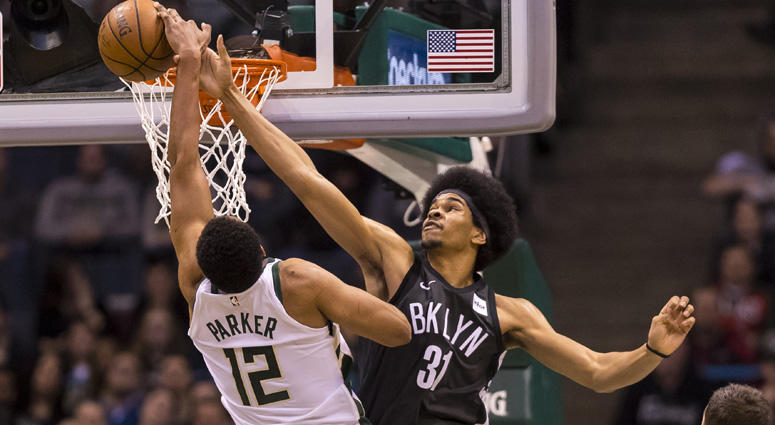 Jarrett Allen blocks the shot of Milwaukee Bucks forward Jabari Parker on April 5, 2018, at BMO Harris Bradley Center in Milwaukee.