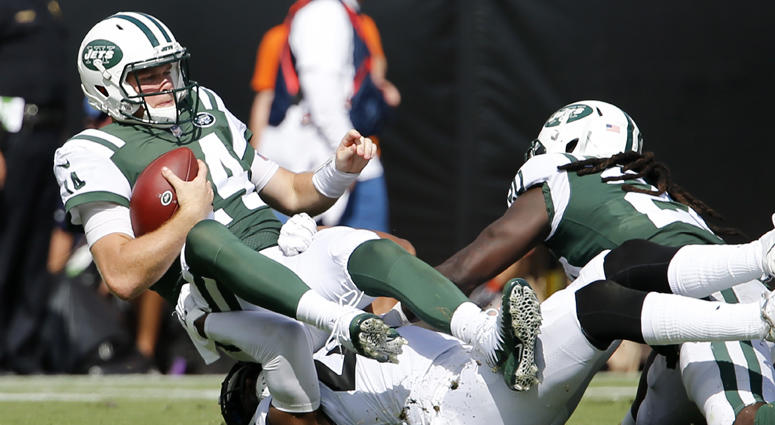 Jets quarterback Sam Darnold is sacked by Jaguars defensive back Barry Church during the second half on Sept. 30, 2018, at TIAA Bank Field in Jacksonville, Florida.
