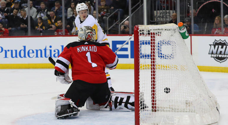 Penguins center Nick Bjugstad (not shown) scores a goal on New Jersey  Devils goaltender 7b09887fa