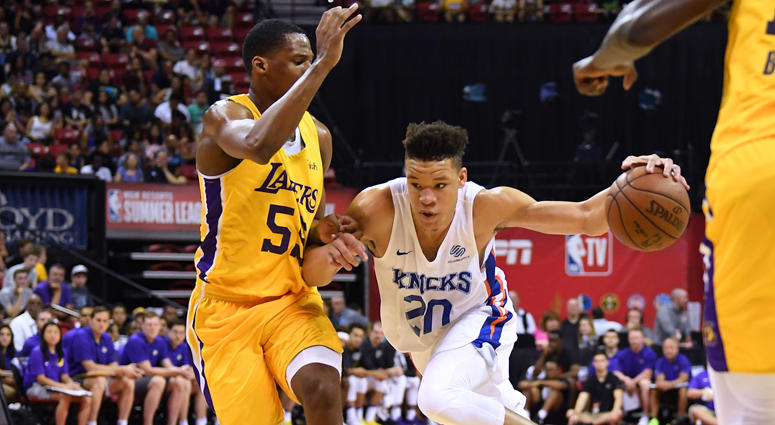 Knicks forward Kevin Knox (20) dribbles against the Lakers' Nick King during a Summer League game on July 10, 2018, at the Thomas & Mack Center in Las Vegas.