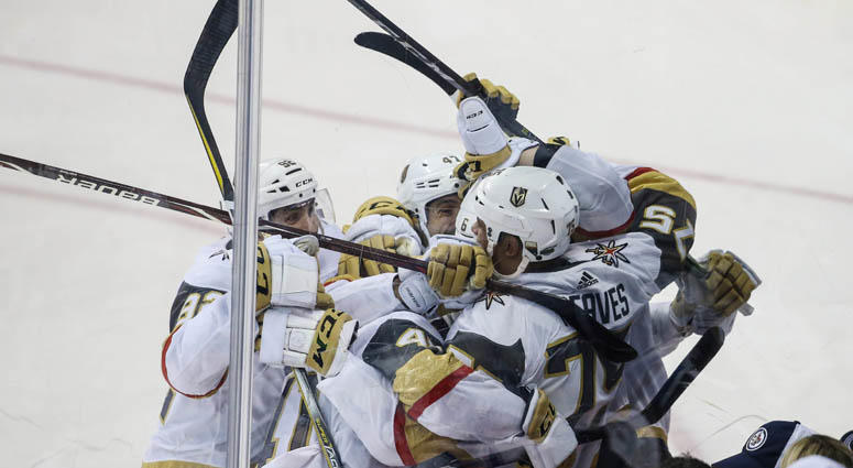 Vegas Golden Knights' Ryan Reaves (75) celebrates with teammates after scoring a goal against the Winnipeg Jets in the second period in Game 5 of the Western Conference finals on May 20, 2018, at Bell MTS Centre in Winnipeg, Canada.