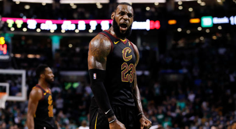 Cleveland Cavaliers forward LeBron James celebrates after drawing foul against the Boston Celtics during the fourth quarter in Game 7 of the Eastern Conference finals on May 27, 2018, at TD Garden in Boston.