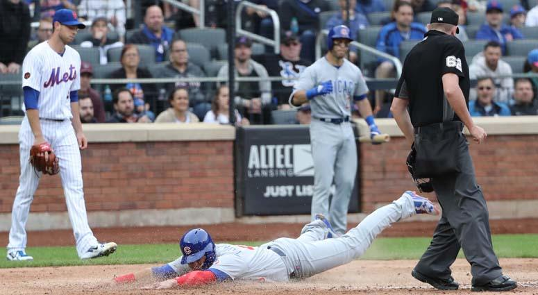 Cubs catcher Willson Contreras dives home to score during the seventh inning against the Mets on June 3, 2018, at Citi Field.