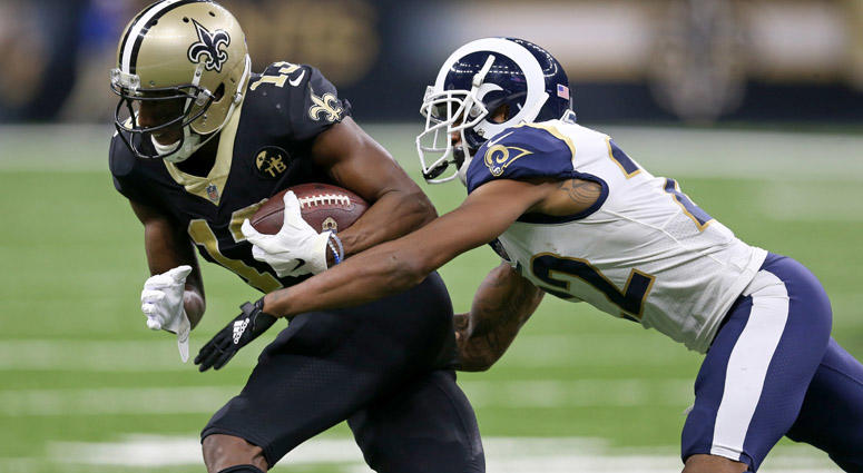 Saints wide receiver Michael Thomas is defended by Rams cornerback Marcus Peters after a catch in the third quarter at the Mercedes-Benz Superdome in New Orleans on Nov. 4, 2018.