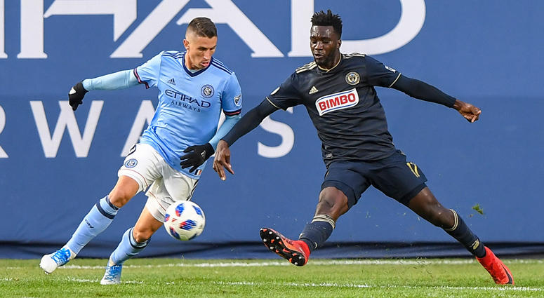 Philadelphia Union forward C.J. Sapong attempts a shot defended by NYCFC's Ben Sweat during a game at Yankee Stadium on Oct. 28, 2018.