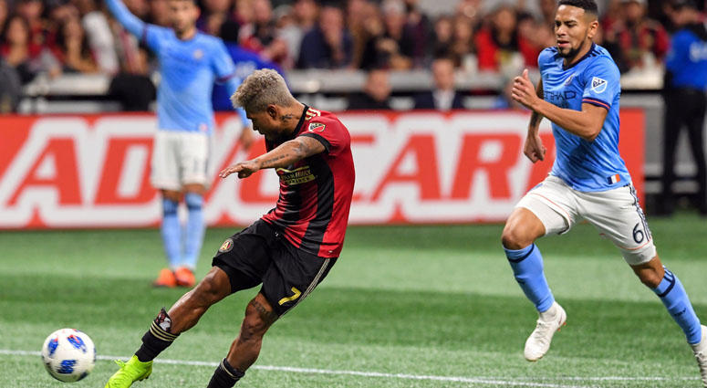 Atlanta United forward Josef Martinez shoots and scores a goal against NYCFC in the Eastern Conference semifinal on Nov. 11, 2018, at Mercedes-Benz Stadium.