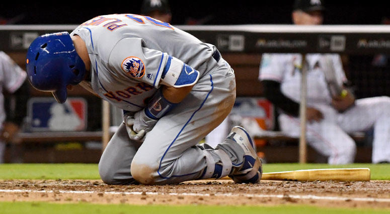 Mets catcher Kevin Plawecki reacts after being hit by a pitch against the Miami Marlins on April 11, 2018, at Marlins Park in Miami.
