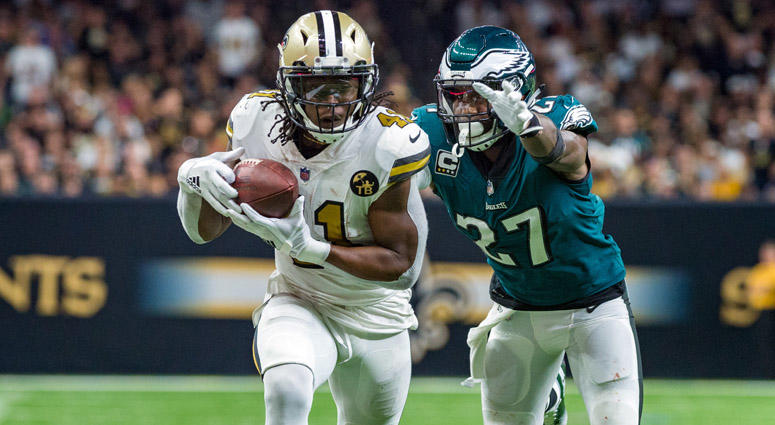 Saints running back Alvin Kamara runs the ball against Eagles safety Malcolm Jenkins on Nov. 18, 2018, at the Mercedes-Benz Superdome in New Orleans.
