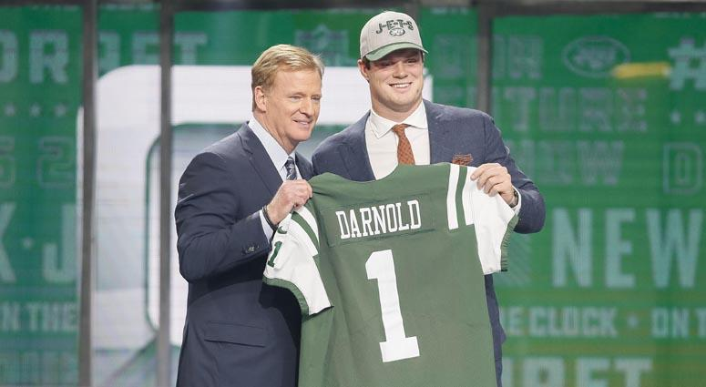 Sam Darnold poses with NFL commissioner Roger Goodell after being drafted third overall by the New York Jets on April 26, 2018 in Arlington, Texas.