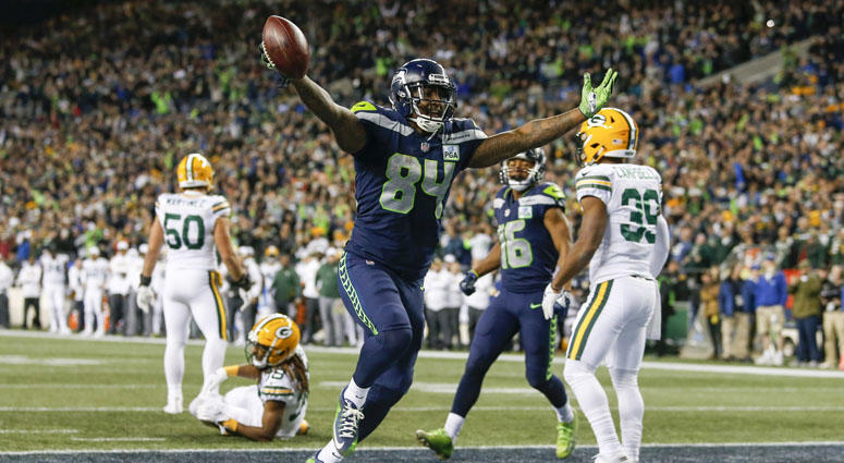 Seattle Seahawks tight end Ed Dickson (84) celebrates after catching a touchdown pass against the Green Bay Packers during the fourth quarter at CenturyLink Field.
