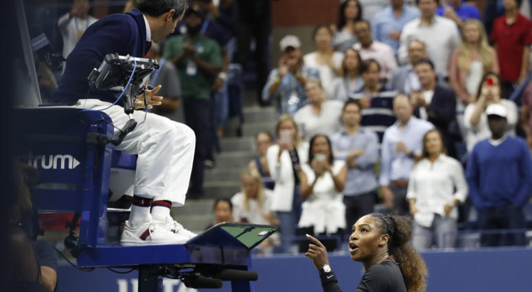 Serena Williams gestures to umpire Carlos Ramos instead of shaking hands after her match against Naomi Osaka in the U.S. Open women's final on Sept. 8, 2018, at the USTA Billie Jean King National Tennis Center.