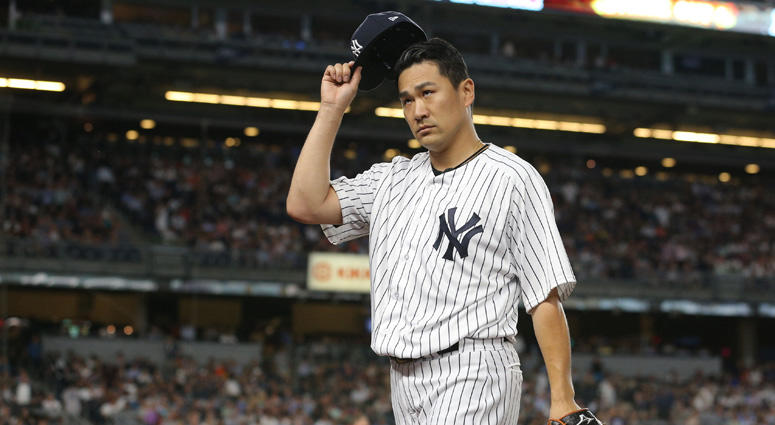 Yankees pitcher Masahiro Tanaka tips his cap after the top of the sixth inning against the Baltimore Orioles on July 31, 2018, at Yankee Stadium.