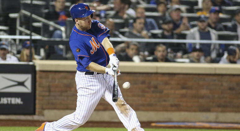 Mets third baseman Todd Frazier hits a two-run home run in the fifth inning against the New York Yankees at Citi Field on June 10, 2018.