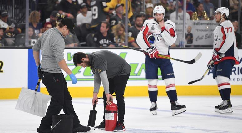 Workers fix the ice in the third period in Game 1 of the Stanley Cup Final on May 28, 2018, at T-Mobile Arena in Las Vegas.