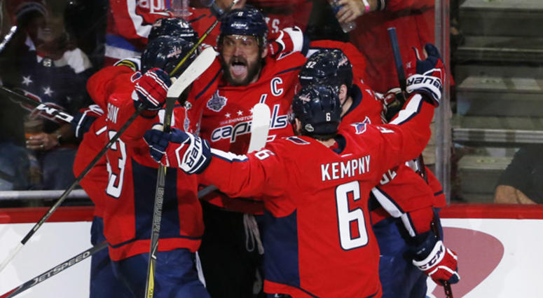 Washington Capitals left wing Alex Ovechkin (8) celebrates with teammates  after scoring a goal b006f724e687