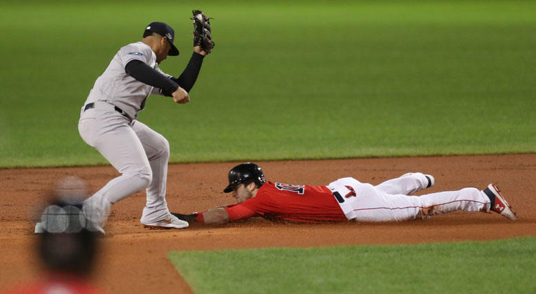 Red Sox left fielder Andrew Benintendi steals second base under Yankees second baseman Gleyber Torres during Game 1 of their ALDS on Oct. 5, 2018, at Fenway Park.