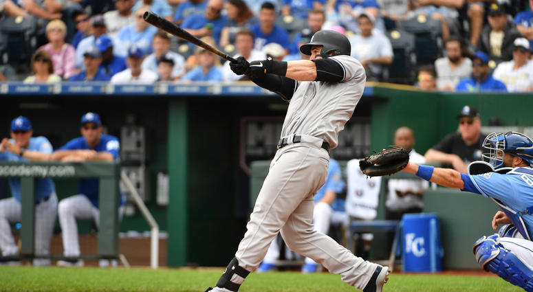 The Yankees' Tyler Austin (26) connects for a two-run home run in the fifth inning against the Royals on May 20, 2018, at Kauffman Stadium in Kansas City, Missouri.