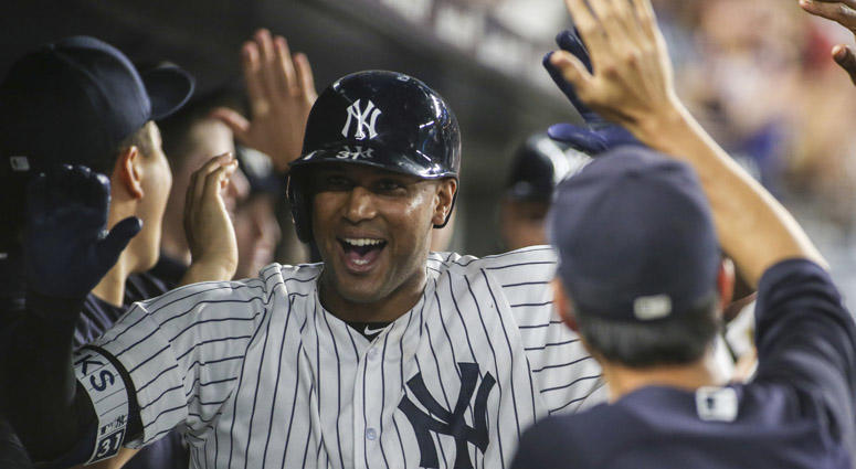 Yankees center fielder Aaron Hicks is greeted in the dugout after hitting a two-run home run in the eighth inning against the Chicago White Sox on Aug. 28, 2018, at Yankee Stadium.
