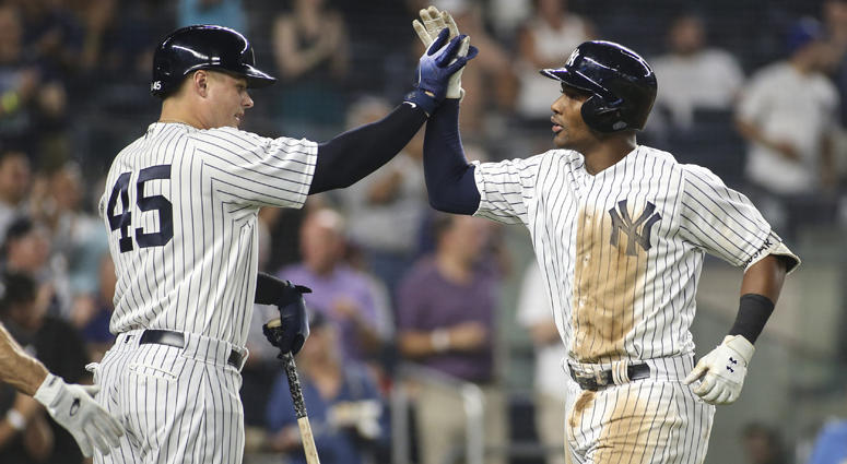Yankees third baseman Miguel Andujar is greeted by Luke Voit after hitting a two-run home run against the Chicago White Sox on Aug. 28, 2018, at Yankee Stadium.