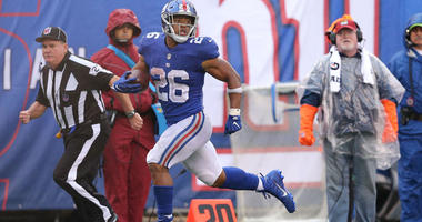 Giants running back Saquon Barkley runs for a touchdown against the Jacksonville Jaguars on Sept. 9, 2018, at MetLife Stadium.