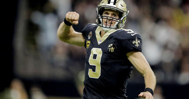 Saints quarterback Drew Brees (9) celebrates after throwing a touchdown pass against the Atlanta Falcons during the second quarter on Nov. 22, 2018, at the Mercedes-Benz Superdome in New Orleans.