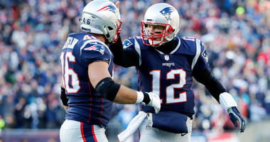 Jan 13, 2019; Foxborough, MA, USA; New England Patriots quarterback Tom Brady (12) and fullback James Develin (46) react after a touchdown during the second quarter in an AFC Divisional playoff game. Mandatory Credit: Winslow Townson-USA TODAY Sports