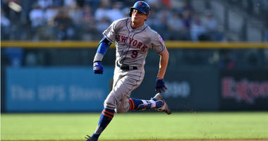 Brandon Nimmo heads to third for an inside the park home run in the first inning against the Colorado Rockies at Coors Field.