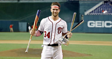 Bryce Harper celebrates winning the 2018 MLB home run derby at Nationals Ballpark.