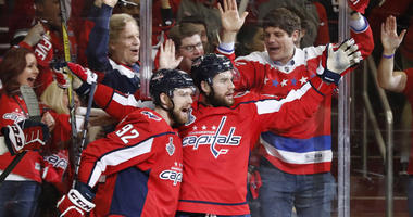 The Capitals' Tom Wilson (43) celebrates with Evgeny Kuznetsov after scoring a goal against the Vegas Golden Knights in the first period in Game 4 of the Stanley Cup Final on June 4, 2018, at Capital One Arena.