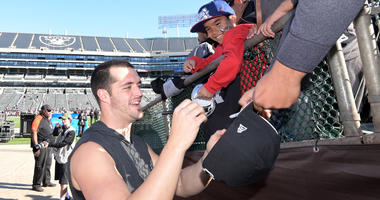Dec 2, 2018; Oakland, CA, USA; Oakland Raiders quarterback Derek Carr (4) signs autographs before the game against the Kansas City Chiefs at Oakland-Alameda County Coliseum. Mandatory Credit: Kirby Lee-USA TODAY Sports