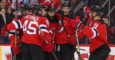 The Devils celebrate a goal by right wing Kyle Palmieri against the San Jose Sharks on Oct. 14, 2018, at the Prudential Center.