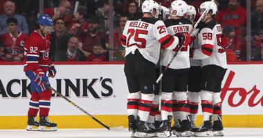 Feb 2, 2019; Montreal, Quebec, CAN; New Jersey Devils center Nico Hischier (13) celebrates his goal against Montreal Canadiens with teammates during the third period at Bell Centre. Mandatory Credit: Jean-Yves Ahern-USA TODAY Sports