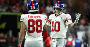 Giants quarterback Eli Manning (10) talks with tight end Evan Engram after an incomplete pass against the Atlanta Falcons on Oct. 22, 2018, at Mercedes-Benz Stadium.