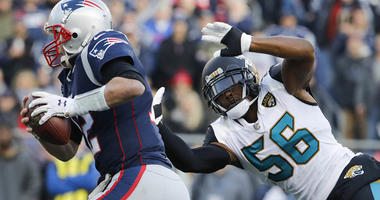 The Jaguars' Dante Fowler Jr. pressures Patriots quarterback Tom Brady during the AFC championship game on Jan. 21, 2018, at Gillette Stadium in Foxborough, Massachusetts.