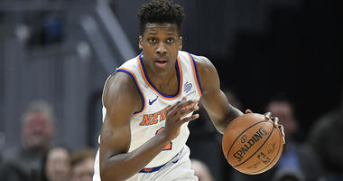 Apr 11, 2018; Cleveland, OH, USA; New York Knicks guard Frank Ntilikina (11) dribbles with the ball in the first quarter against the Cleveland Cavaliers at Quicken Loans Arena. Mandatory Credit: David Richard-USA TODAY Sports